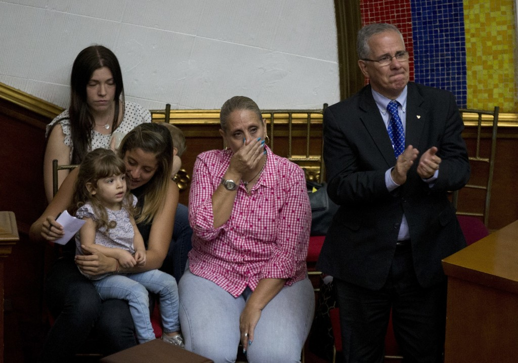 The family of lawmaker Juan Requesens, father Juan Requesens, right, mother Paula Martinez, center, sister Rafalea, left, and wife Oriana Granati atte