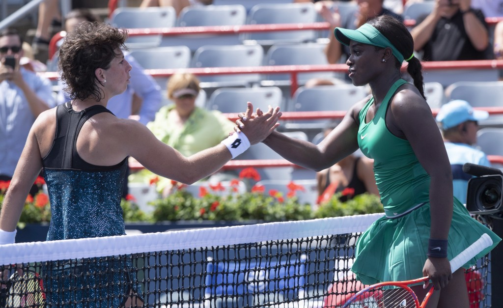 Sloane Stephens, of the Unites States, right, is congratulated by Carla Suarez Navarro, of Spain, following her victory at the Rogers Cup women's tenn
