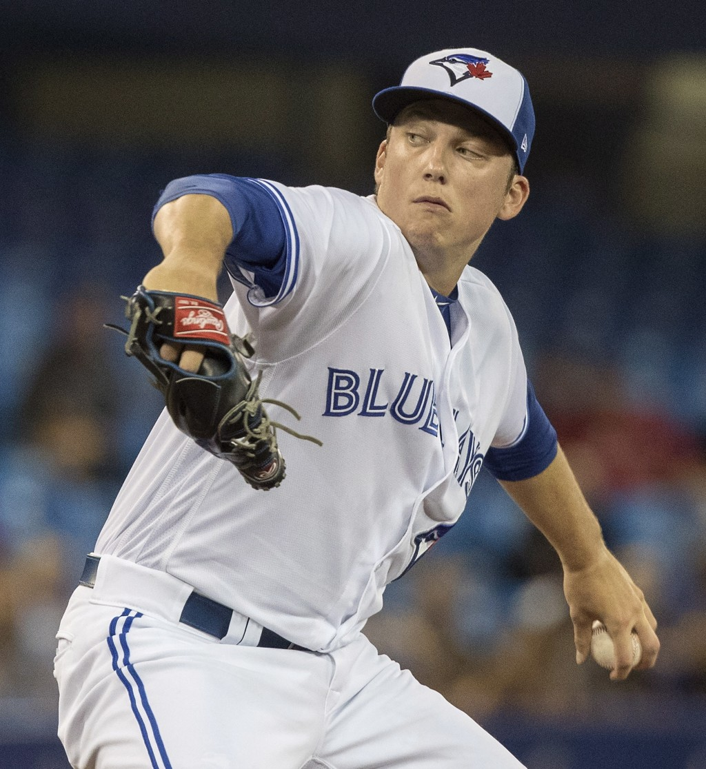 Toronto Blue Jays starting pitcher Ryan Borucki throws to a Boston Red Sox batter during the first inning of a baseball game Thursday, Aug. 9, 2018, i