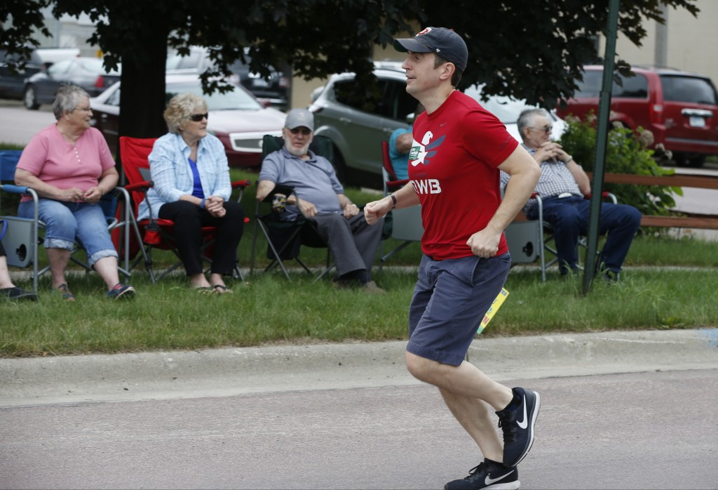 In this June 10, 2018 photo, Minnesota 1st District congressional candidate Dan Feehan jogs past parade goers in Waterville, Minn. Waterville's 54th a