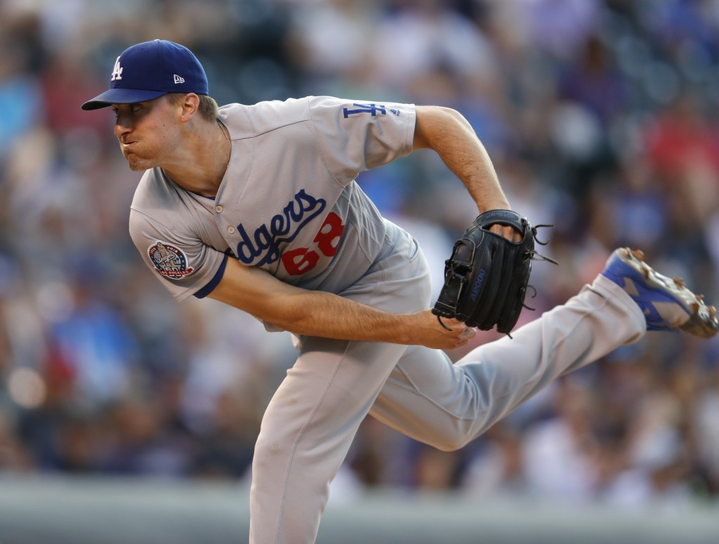 Los Angeles Dodgers starting pitcher Ross Stripling works against the Colorado Rockies in the first inning of a baseball game Thursday, Aug. 9, 2018,