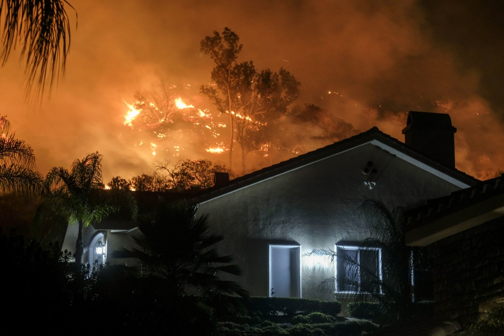 The Holy Fire burns in the Cleveland National Forest at a hillside near homes in Lake Elsinore, Calif., Thursday, Aug. 9, 2018. (AP Photo/Ringo H.W. C