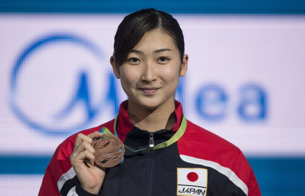 FILE - In this Dec. 11, 2016, file photo, Rikako Ikee, of Japan holds up her bronze medal for in the women's 100-meter butterfly at the FINA World Swi