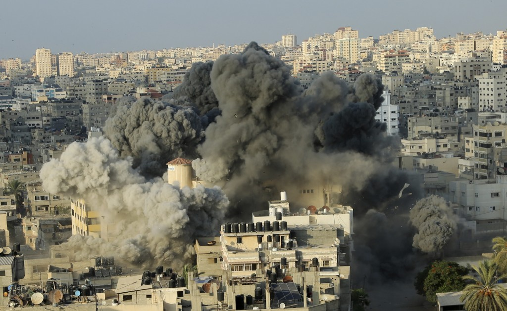 Smoke rises from an explosion caused by an Israeli airstrike on a building of Said al-Mis'hal cultural center in Gaza City, Thursday, Aug. 9, 2018. Pa...