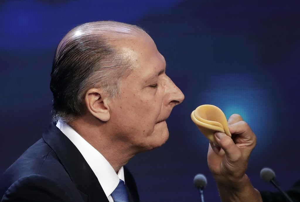 Geraldo Alckmin, former Sao Paulo governor and presidential hopeful with the Social Democratic Party, gets his make up done during a break at a presid...