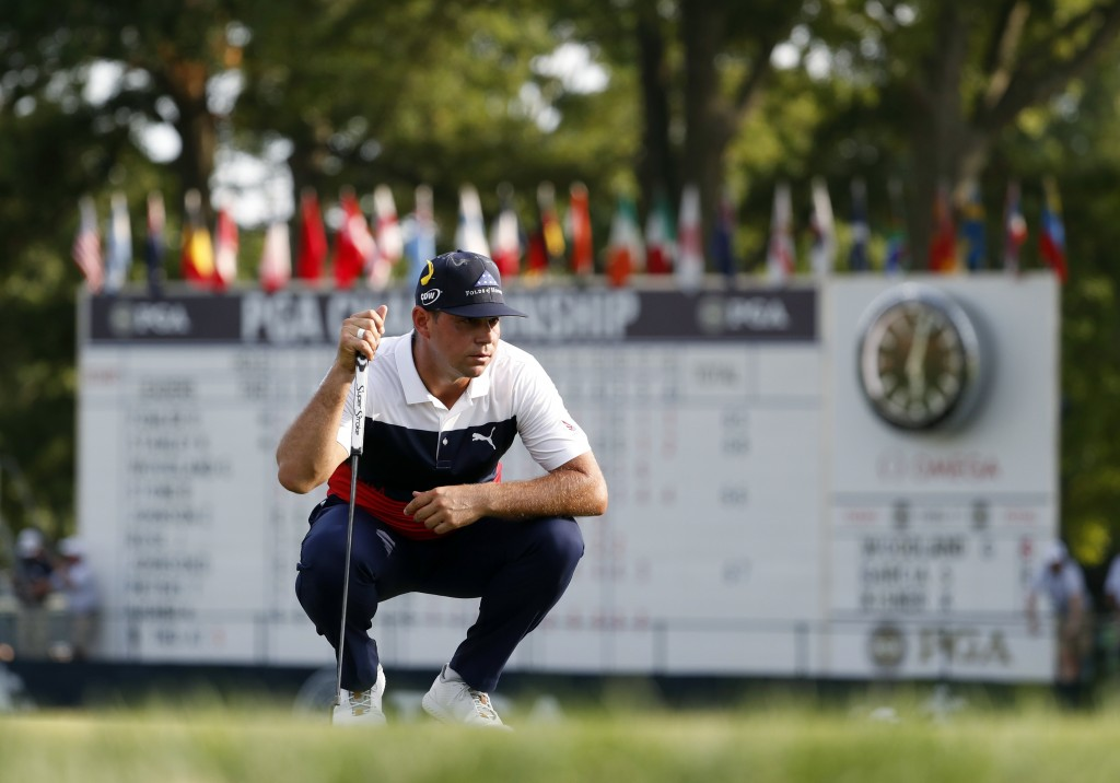 Gary Woodland looks at a putt on the 18th green during the first round of the PGA Championship golf tournament at Bellerive Country Club, Thursday, Au