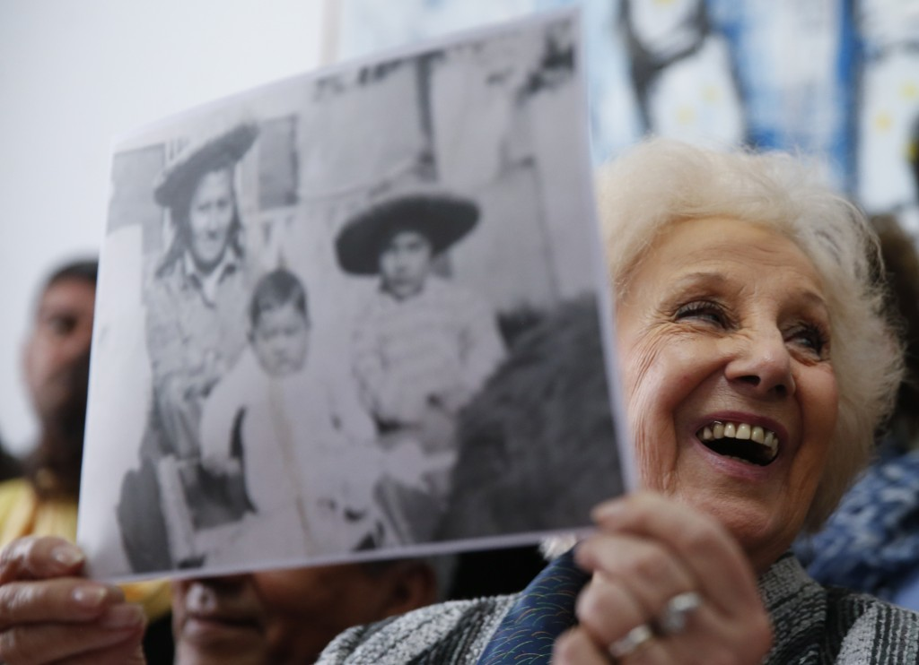 In this Friday, Aug. 3, 2018 photo, Estela de Carlotto, president of the Grandmothers of Plaza de Mayo human rights group, holds a photo of Rosario de