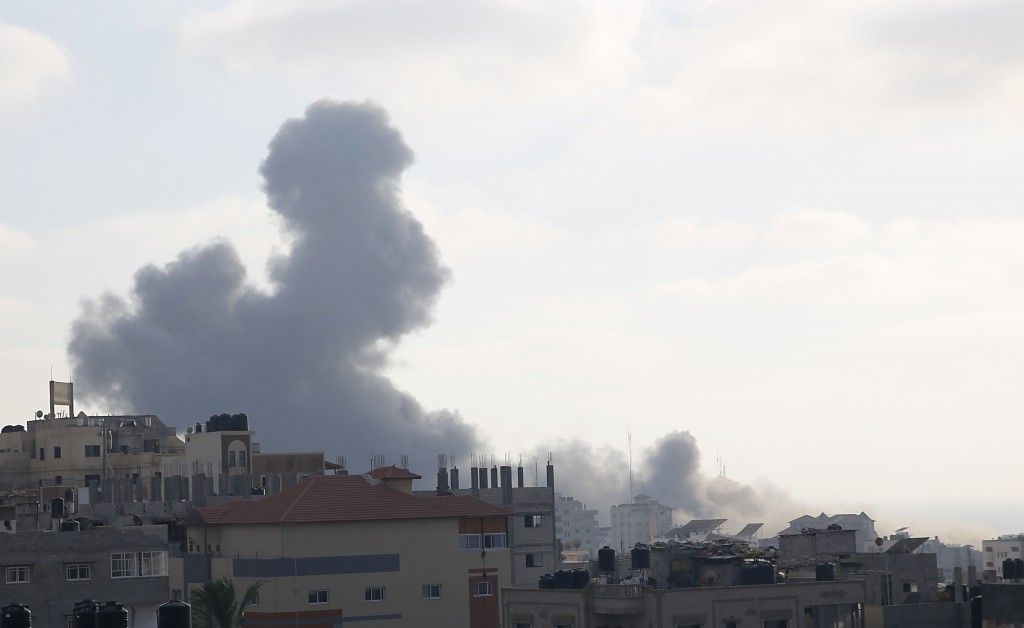 Smoke rises from an explosion caused by an Israeli airstrike in Gaza City, Thursday, Aug. 9, 2018. Israeli warplanes have hit dozens of targets in the