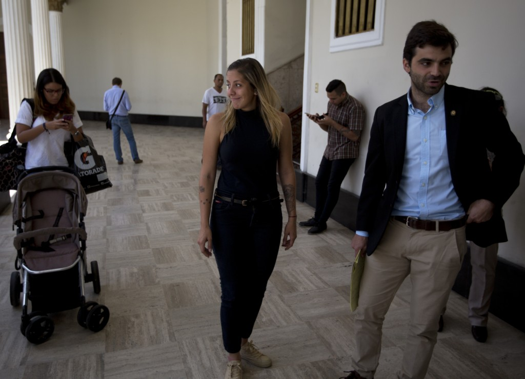 Rafaela Requesens, center, sister of Venezuelan lawmaker Juan Requesens, smiles upon her arrival to National Assembly to attend a special session, in