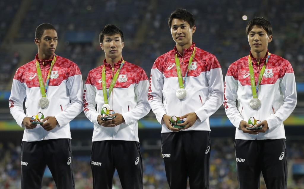 FILE - In this Aug. 19, 2016, file photo, Japan's Ryota Yamagata, Shota Iizuka, Yoshihide Kiryu and Aska Cambridge celebrate on the podium after winni