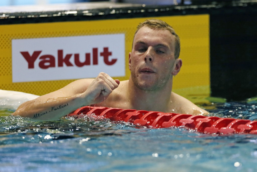 Australia's Kyle Chalmers reacts after winning the men's 100m freestyle final during the Pan Pacific swimming championships in Tokyo, Friday, Aug. 10,