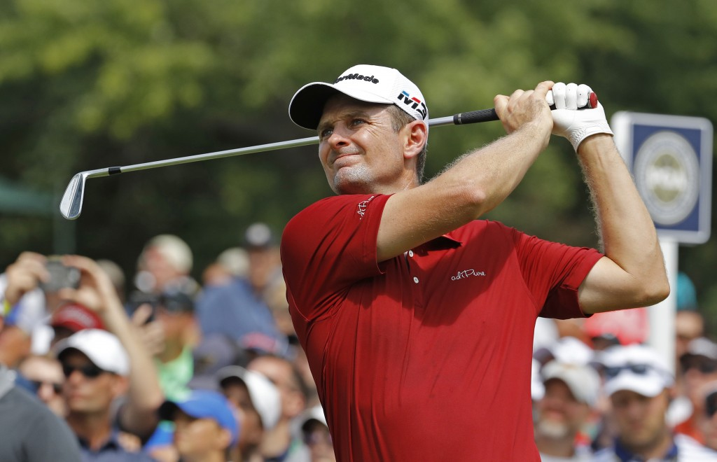 Justin Rose, of England, watches his tee shot on the sixth hole during the first round of the PGA Championship golf tournament at Bellerive Country Cl