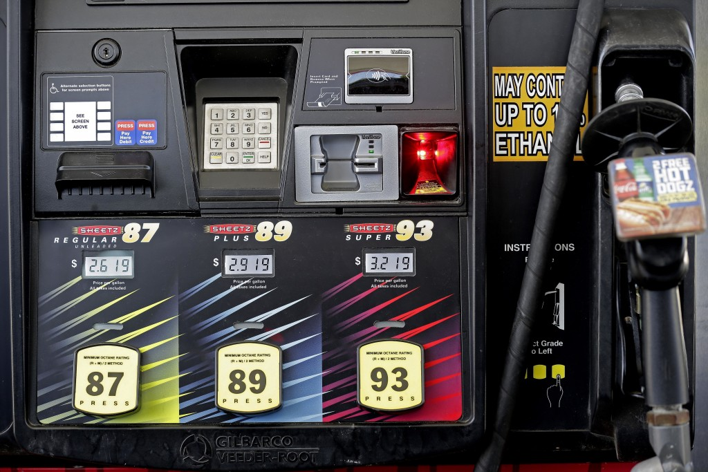 FILE- In this June 14, 2018, file photo,  gasoline prices are displayed on a pump at Sheetz along the Interstate 85 and 40 corridor near Burlington, N