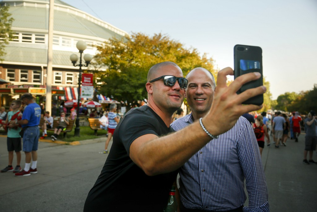 Michael Avenatti, the lawyer representing adult film actress Stormy Daniels, poses for a selfie with a fairgoer at the Iowa State Fair in Des Moines,