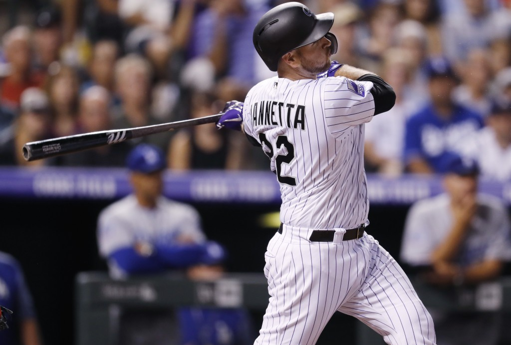 Colorado Rockies' Chris Iannetta follows the flight of his three-run home run off Los Angeles Dodgers relief pitcher Pedro Baez in the seventh inning