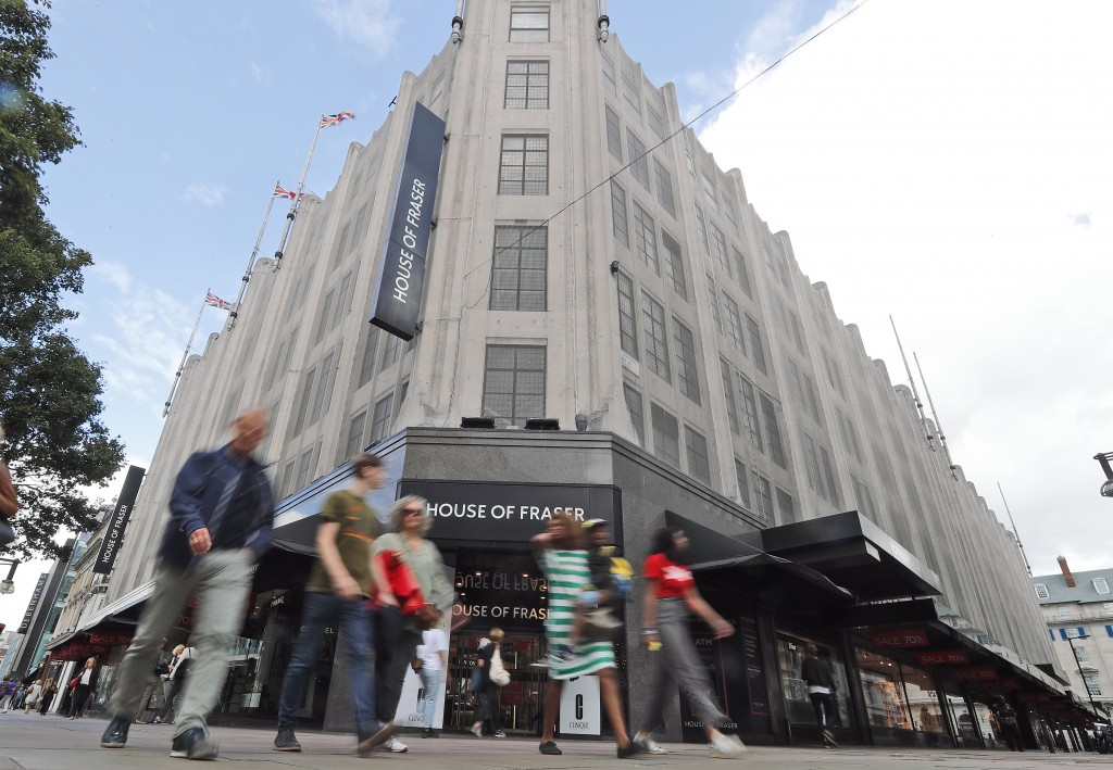 Pedestrians walk past the House of Fraser department store on Oxford Street in London, Friday, Aug. 10, 2018.  British retailer Sports Direct said Fri