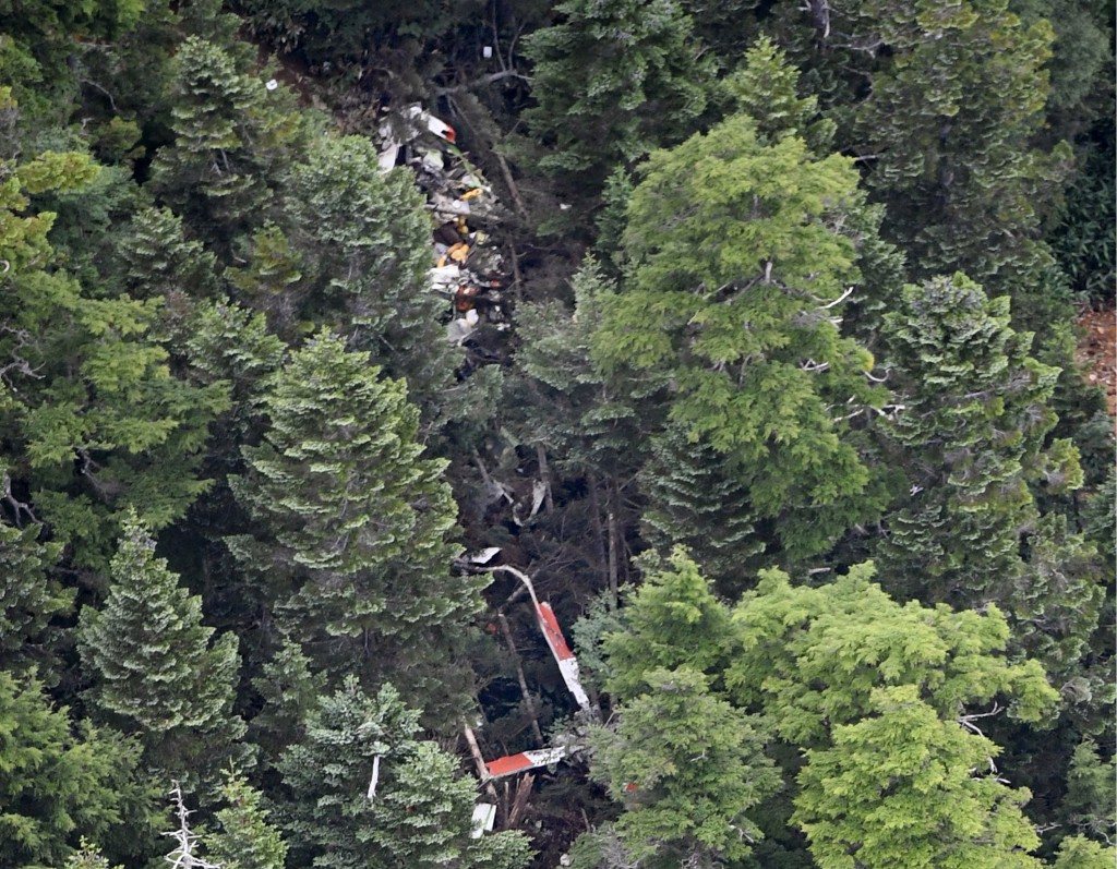 The wreckage of Gunma prefectural air rescue helicopter Haruna is seen after crashing in Nakanojo town, Gunma prefecture, northwest of Tokyo Friday, A