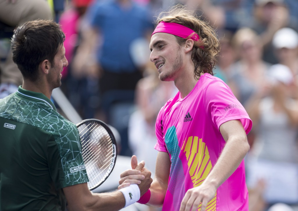 Novak Djokovic, left, of Serbia, congratulates Stefanos Tsitsipas, of Greece, after their match at the Rogers Cup men's tennis tournament in Toronto,