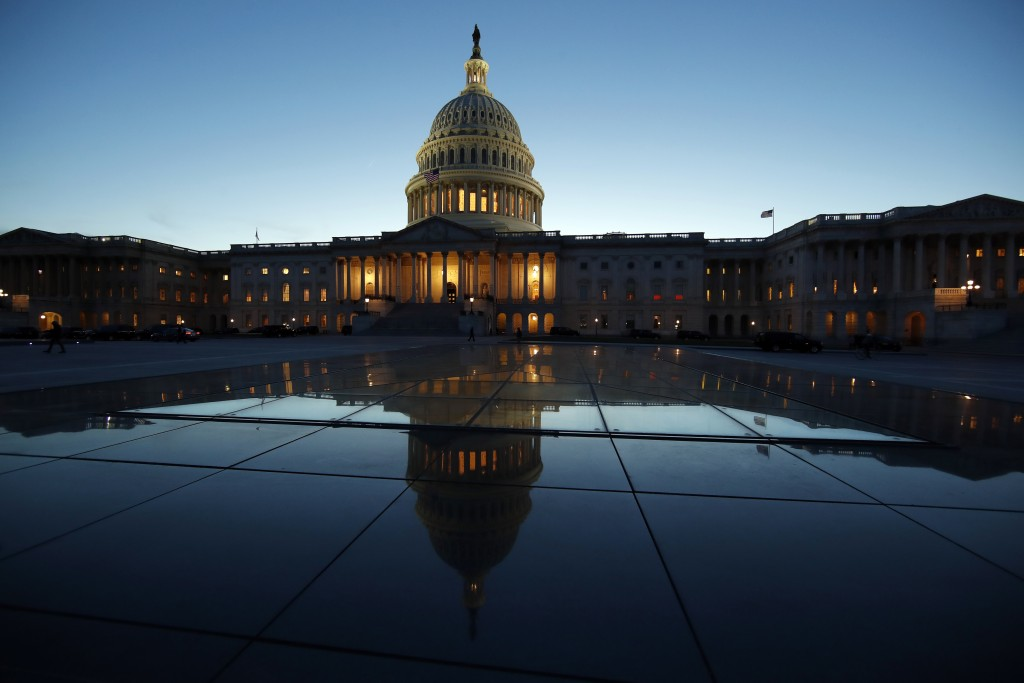 FILE- This March 5, 2018, file photo show the East Front of the U.S. Capitol at sunset in Washington. On Friday, Aug. 10, the Treasury Department rele...