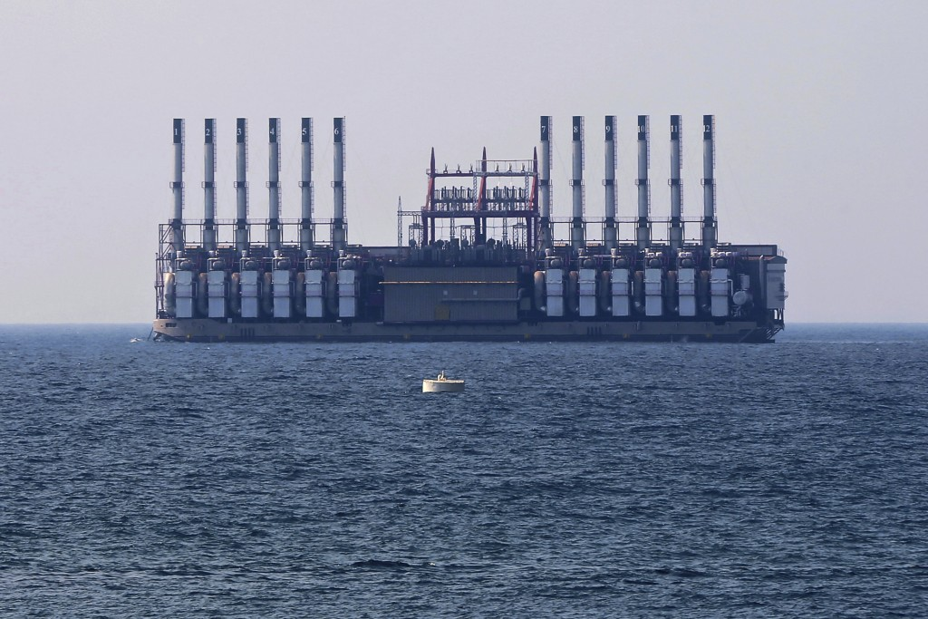 In this July 16, 2018 photo, a floating power station waits off the coast at Jiyeh, south of Beirut, Lebanon. It was supposed to be a goodwill gesture