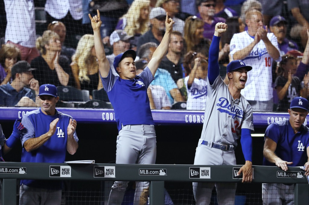 Los Angeles Dodgers' Enrique Hernandez cheers with teammates after Chris Taylor hit a solo home run off Colorado Rockies relief pitcher Wade Davis dur