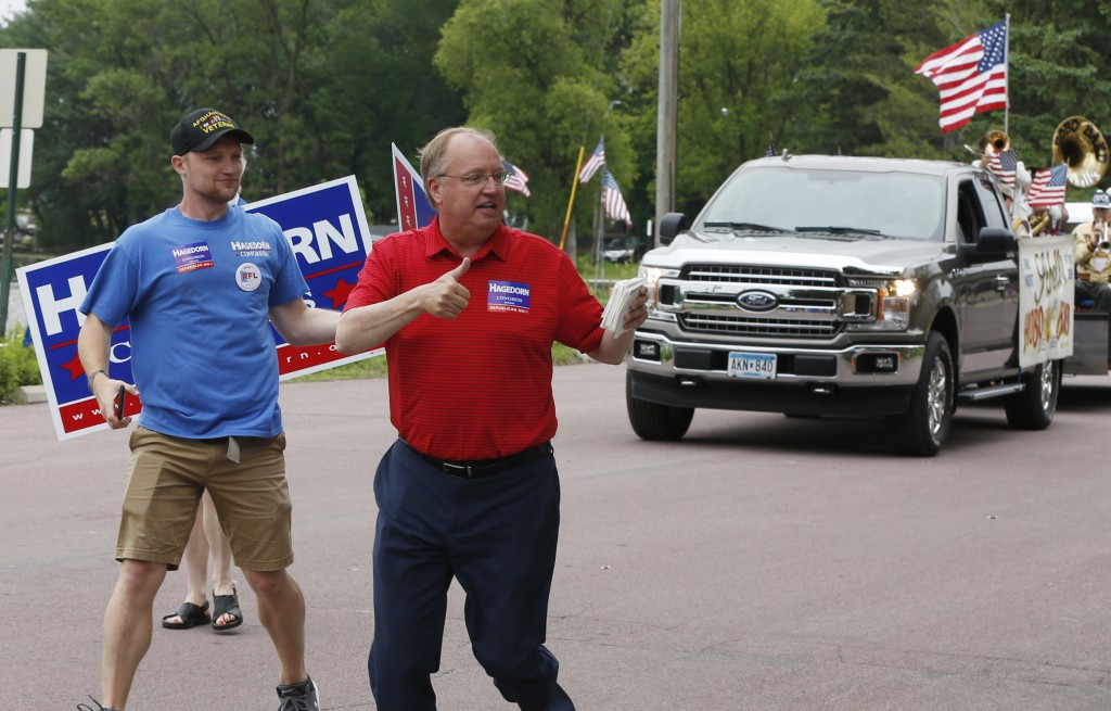 In this June 10, 2018 photo, Minnesota 1st District congressional candidate Jim Hagedorn gives a thumbs up as he works a parade in Waterville, Minn. W