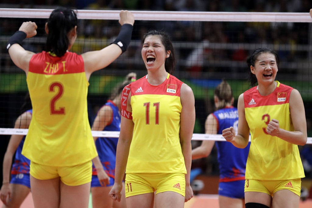 FILE - In this Aug. 20, 2016, file photo China's Xu Yunli (11) celebrates with teammates Zhu Ting (2) and Yang Fangxu (3) during a women's gold medal