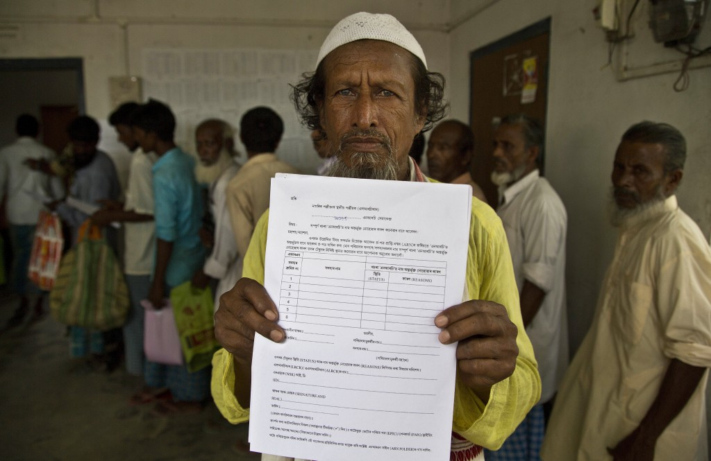 Kismat Ali, whose wife's name did not appear on the National Register of Citizens (NRC) draft,  shows a form he collected to file an appeal in Mayong,