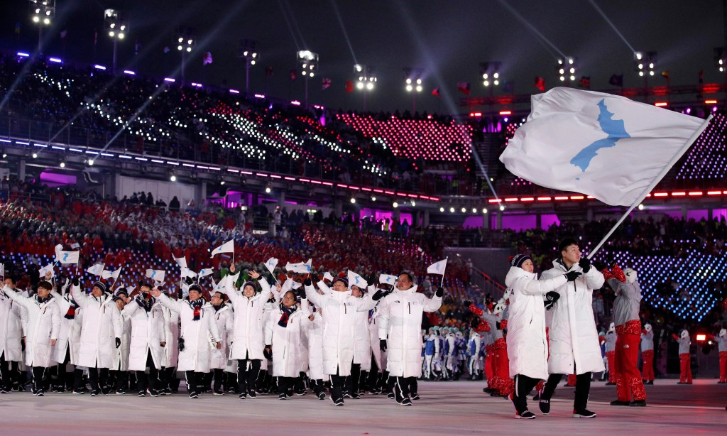 FILE - In this Feb. 9, 2018, file photo, North Korea's Hwang Chung Gum and South Korea's Won Yun-jong carry the unification flag during the opening ce
