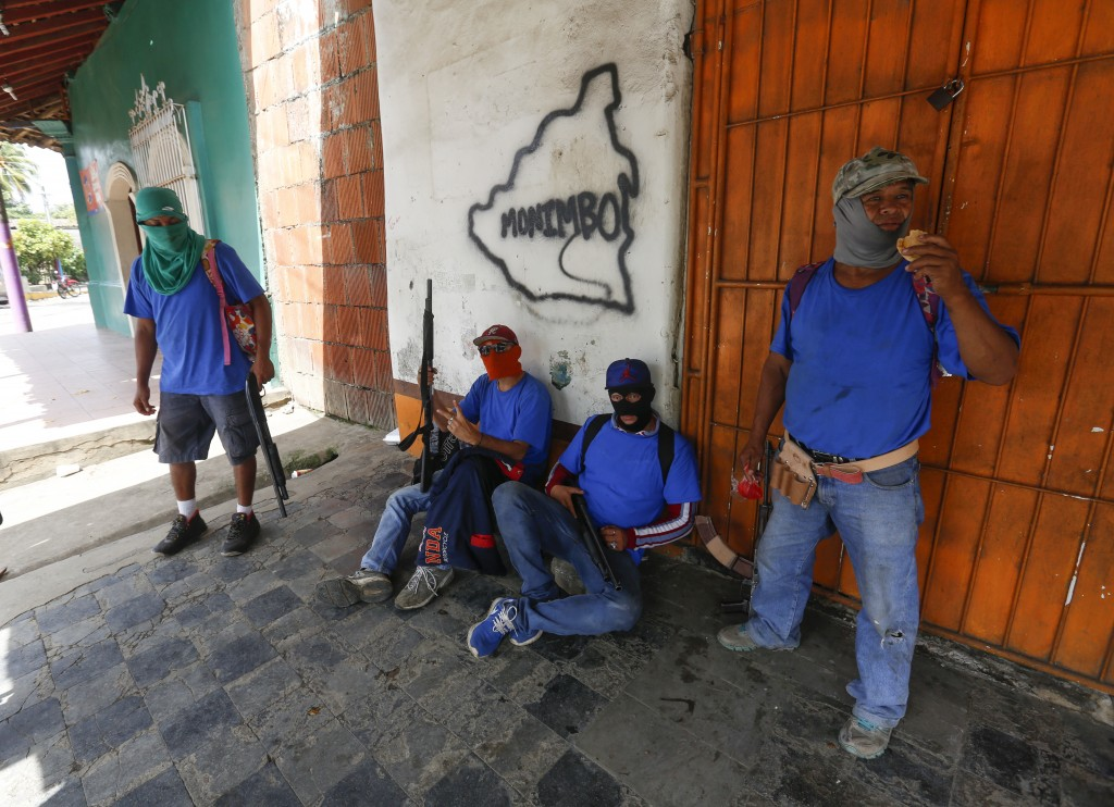 FILE- In this July 18, 2018 file photo, heavily armed pro-government militia occupy the Monimbo neighborhood of Masaya, Nicaragua. President Daniel Or
