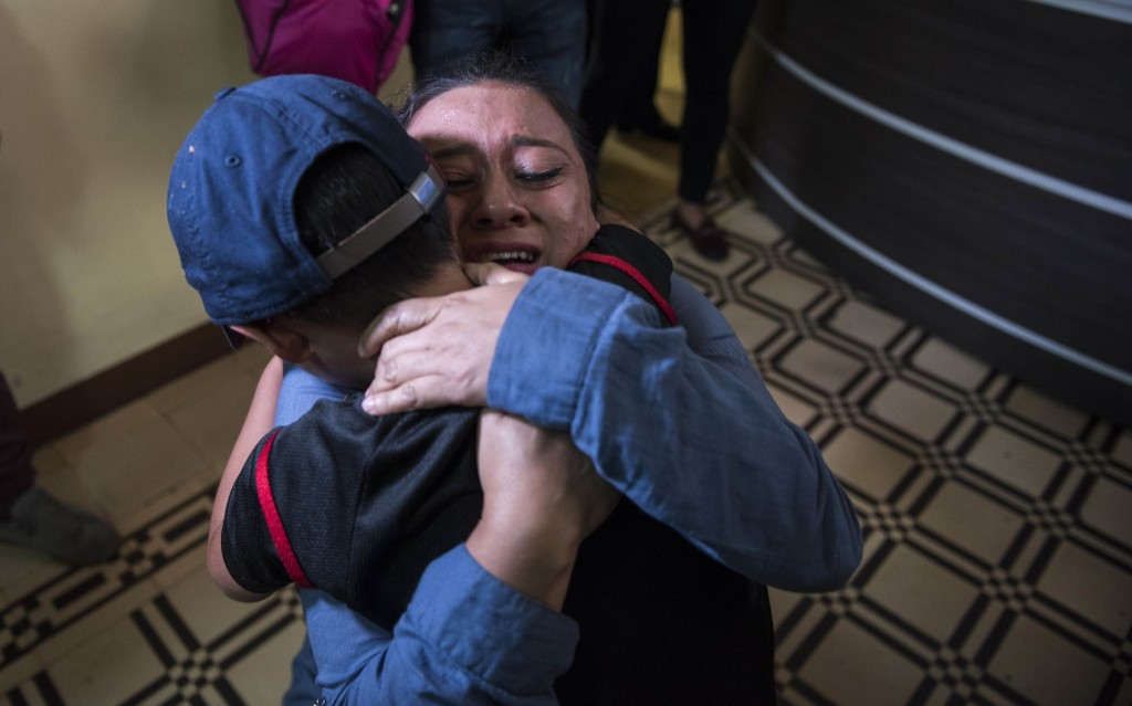 "In this Tuesday, Aug. 7, 2018 photo, Lourdes de Leon hugs her 6-year-old son Leo Jeancarlo de Leon as they are reunited at the shelter ""Nuestras Raíce"
