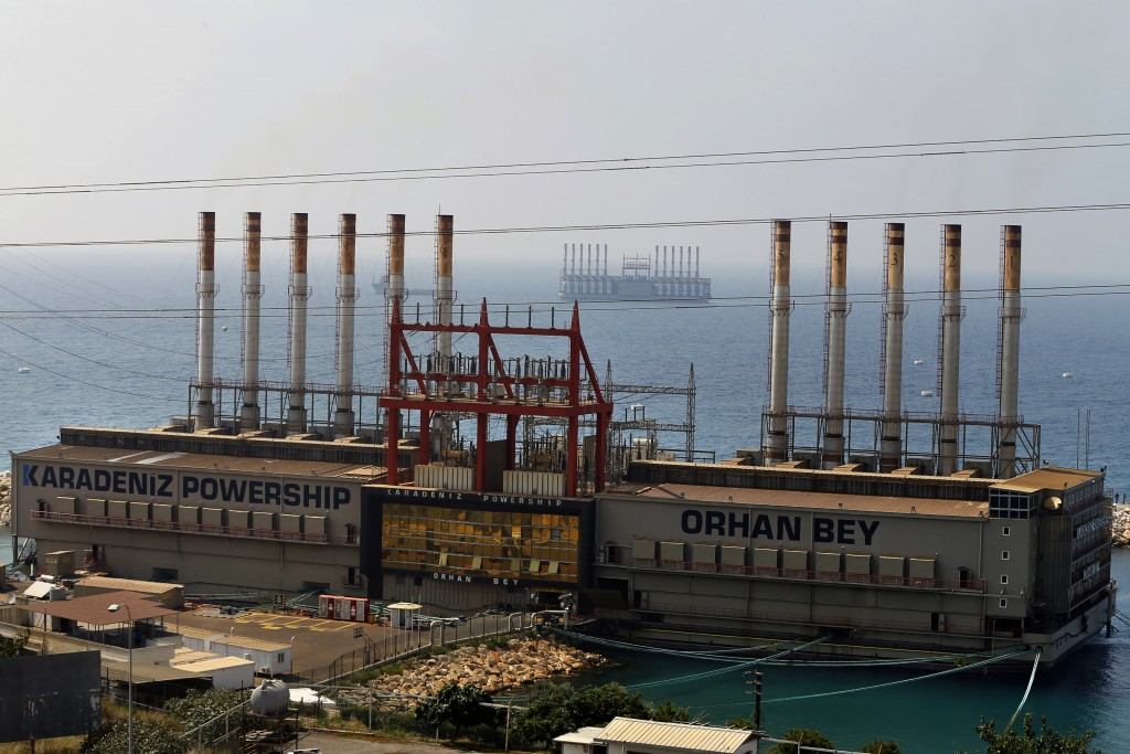 This July 16, 2018 photo, shows the Karadeniz Powership Orhan Bey, foreground, and a second floating power station off the coast at Jiyeh, south of Be