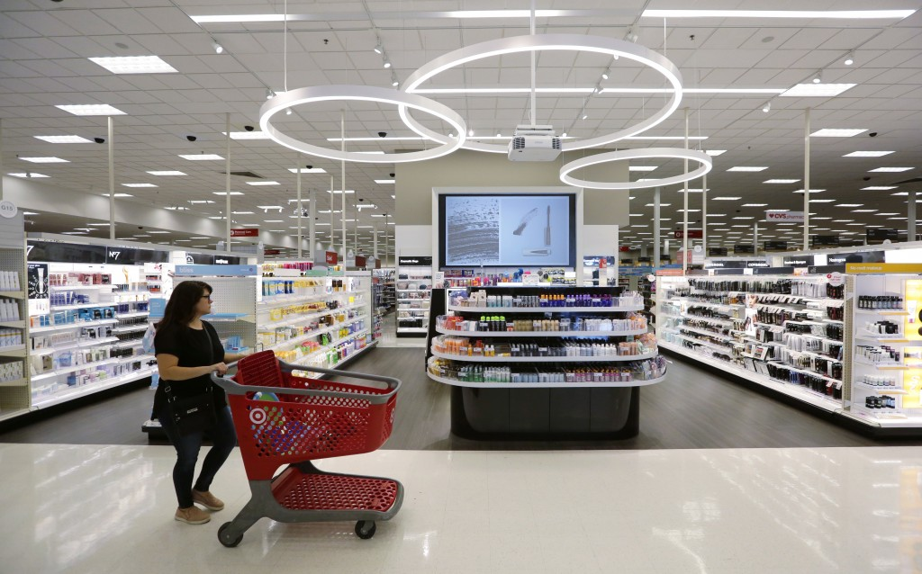 FILE- In this May 30, 2018, file photo, a shopper walks through the updated cosmetic department at a Target store in San Antonio. On Friday, Aug. 10,