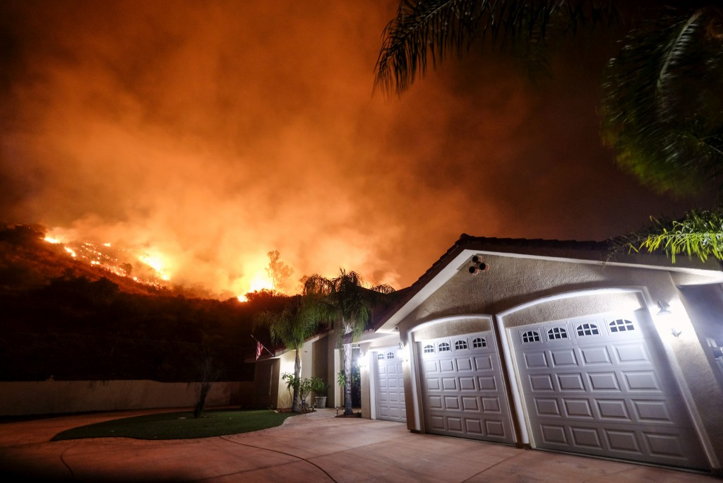 The Holy Fire burns near homes in the Cleveland National Forest in Lake Elsinore, Calif., Thursday, Aug. 9, 2018. (AP Photo/Ringo H.W. Chiu)
