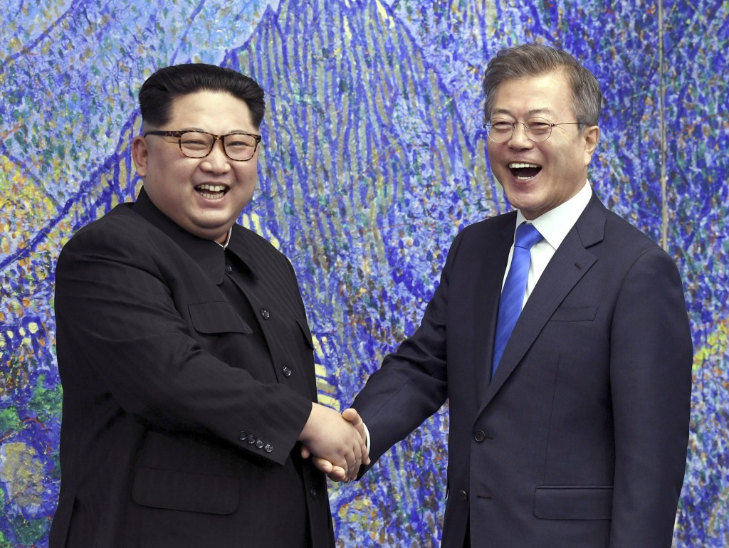 FILE - In this April 27, 2018, file photo, North Korean leader Kim Jong Un, left, poses with South Korean President Moon Jae-in for a photo inside the