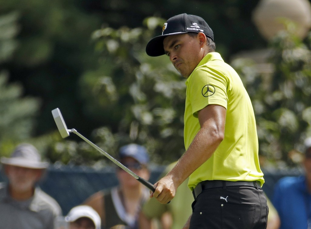 Rickie Fowler watches a putt on the fifth hole during the first round of the PGA Championship golf tournament at Bellerive Country Club, Thursday, Aug