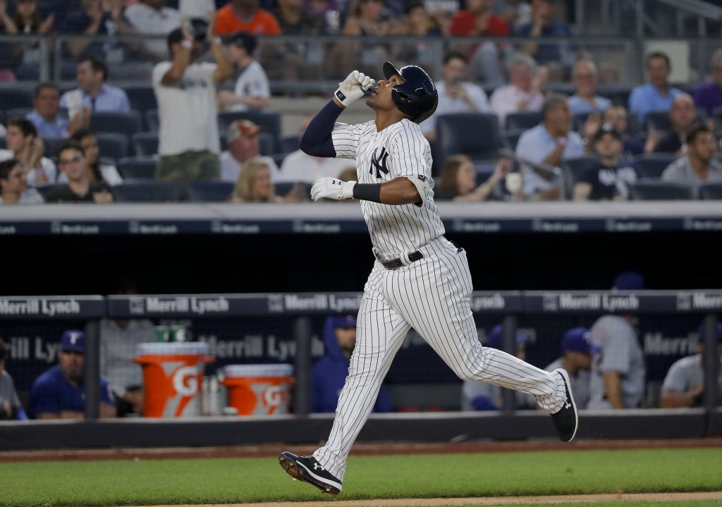 New York Yankees' Miguel Andujar reacts as he heads down the third base line after hitting a two-run home run against the Texas Rangers during the fou