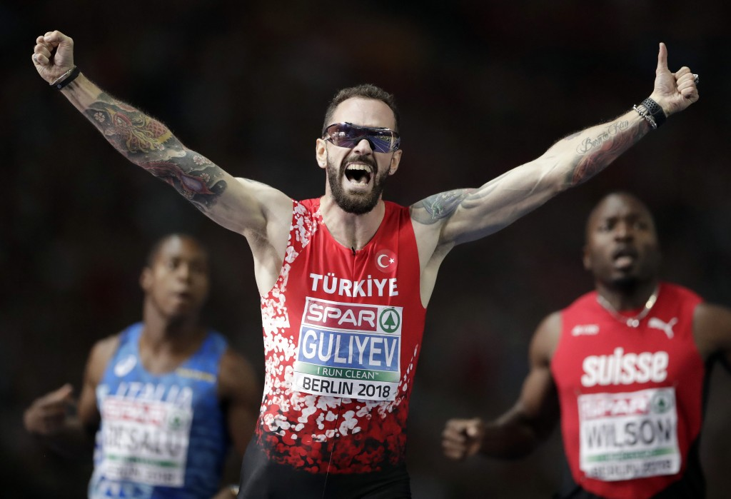 Turkey's Ramil Guliyev celebrates winning the men's 200 meter final race at the European Athletics Championships in Berlin, Germany, Thursday, Aug. 9,