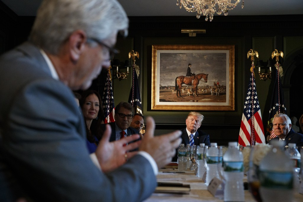 President Donald Trump looks to Mississippi Gov. Phil Bryant, left, as he speaks during a meeting with state leaders about prison reform, Thursday, Au