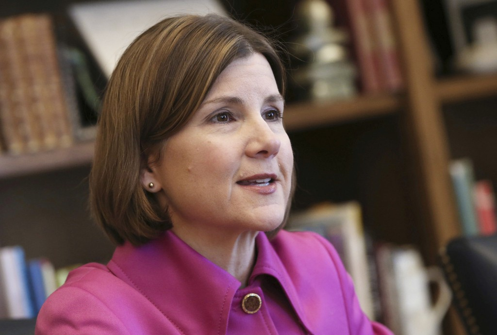 FILE - In this March 12, 2018, file photo, Minnesota Attorney General Lori Swanson speaks during an interview at the Capitol in St. Paul. Swanson's ca