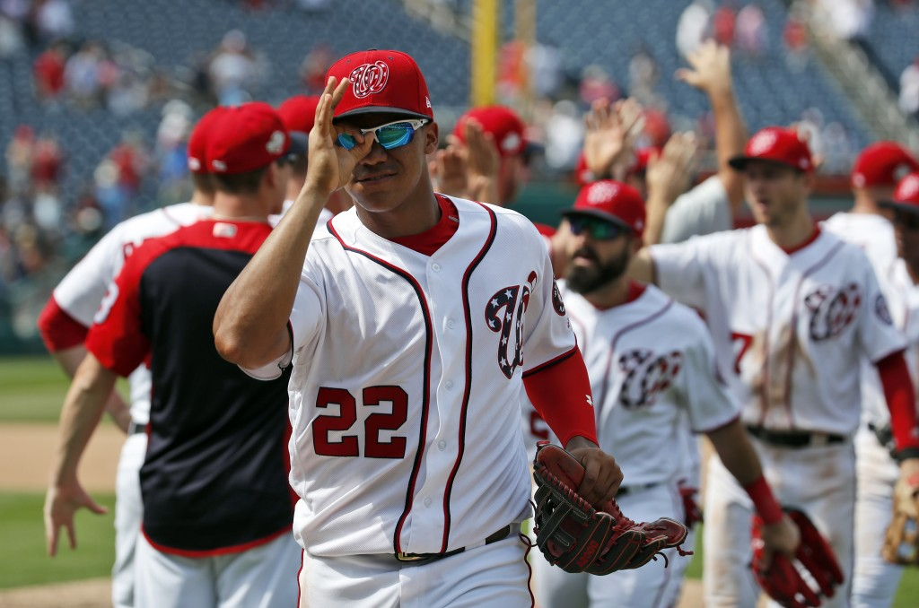 Washington Nationals' Juan Soto (22) celebrates with his teammates after a baseball game against the Atlanta Braves at Nationals Park, Thursday, Aug.
