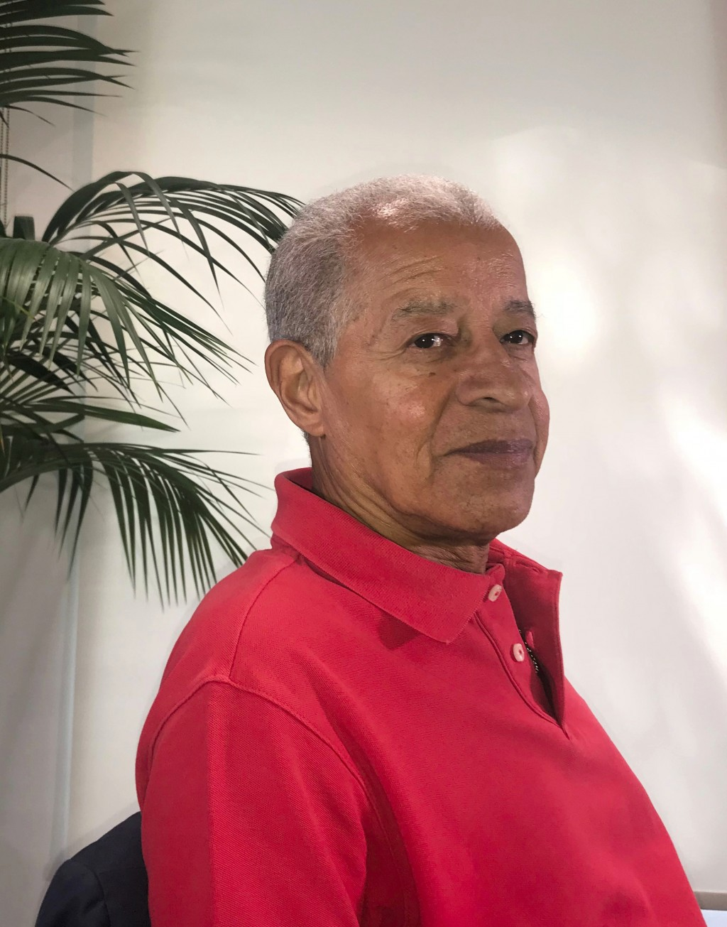 Herman Ouseley, chairman of English soccer anti-discrimination group entitled Kick It Out, poses for a photo after an interview with The Associated Pr
