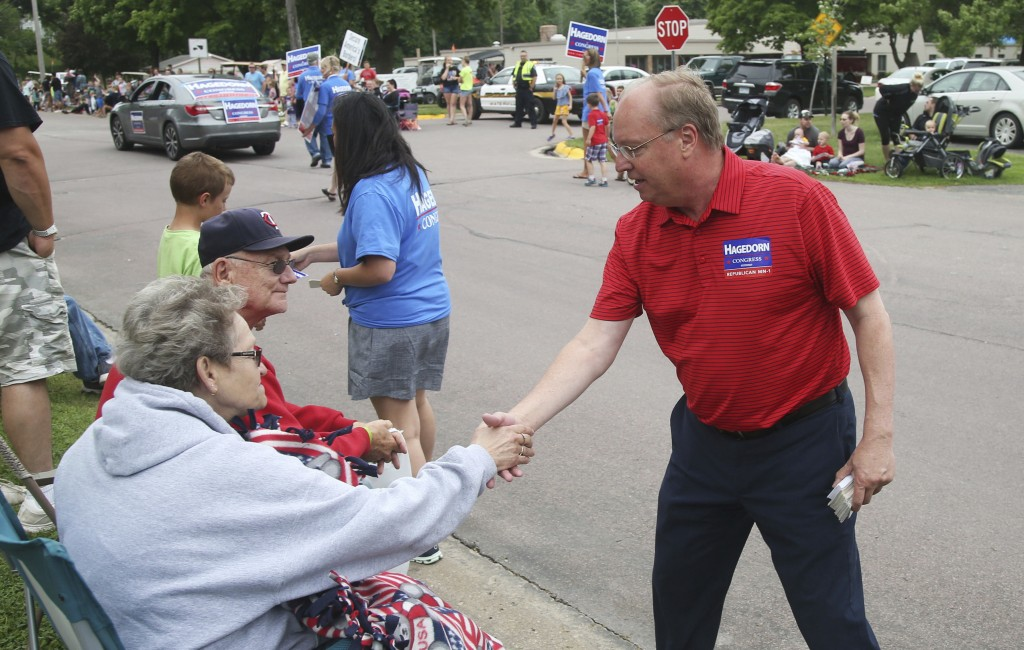 In this June 10, 2018 photo, Minnesota 1st District congressional candidate Jim Hagedorn works a parade in Waterville, Minn. Waterville's 54th annual