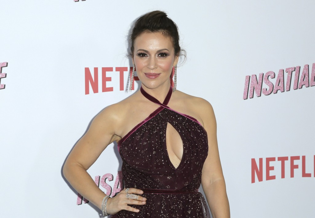 """Alyssa Milano arrives at the LA Premiere of """"Insatiable"""" at the Arclight Hollywood on Thursday, Aug. 9, 2018, in Los Angeles. (Photo by Willy Sanjuan/"""