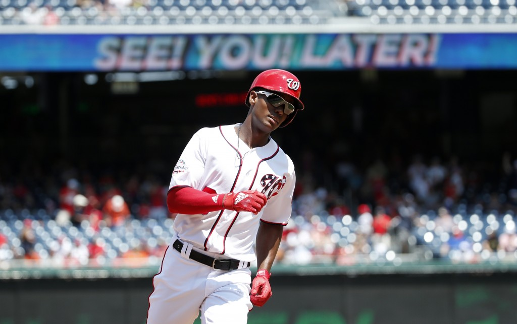 Washington Nationals' Michael Taylor rounds the bases after hitting a solo home run during the fourth inning of a baseball game against the Atlanta Br