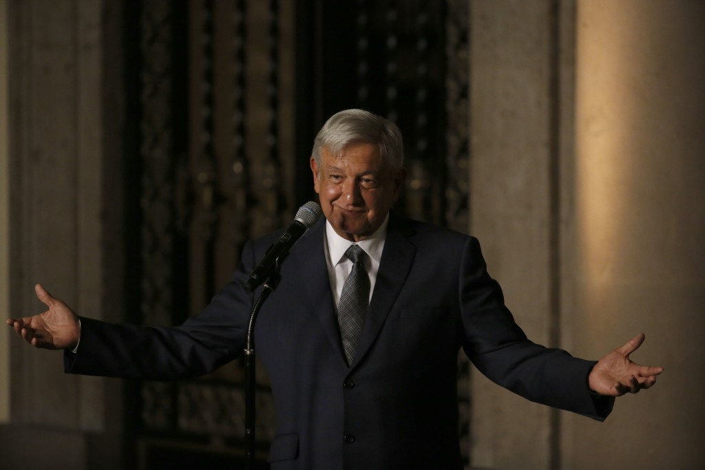 Mexico's President-elect Andres Manuel Lopez Obrador speaks to reporters after meeting with Mexico's President Enrique Pena Nieto at the National Pala