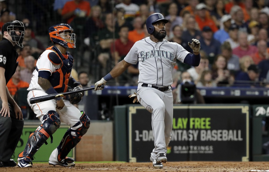 Seattle Mariners' Denard Span watches his two-run home run in front of Houston Astros catcher Martin Maldonado during the second inning of a baseball