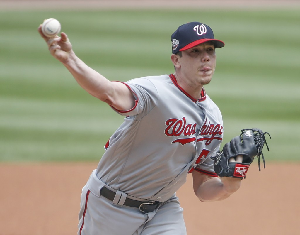 Washington Nationals starting pitcher Jeremy Hellickson delivers against the Chicago Cubs during the first inning of a baseball game, Friday, Aug. 10,