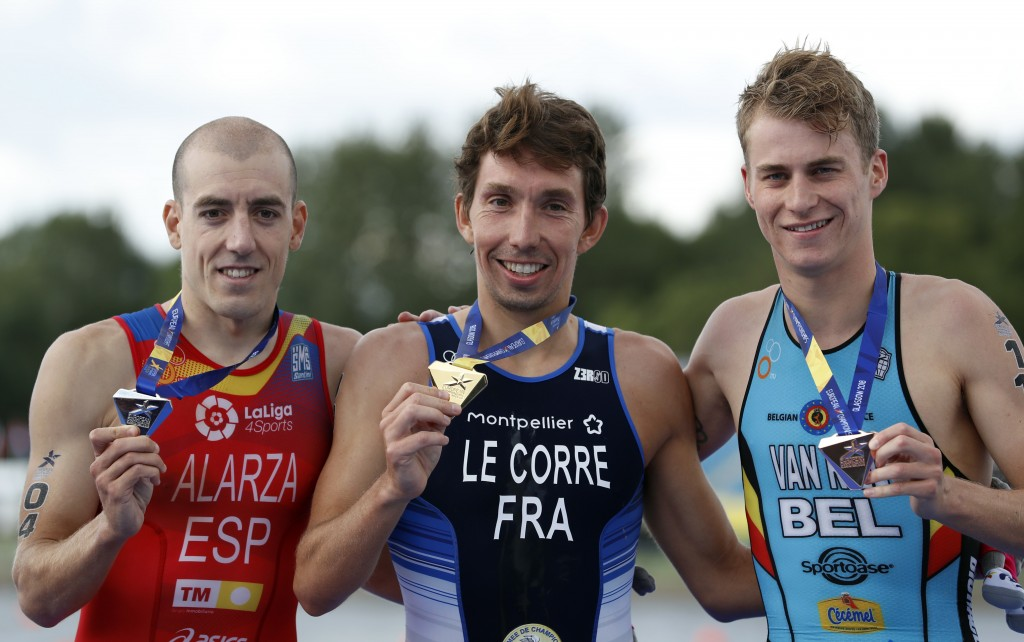 Pierre Le Corre of France, center, celebrates with the gold medal after winning the men's triathlon finals at Strathclyde Country Park during the Euro...