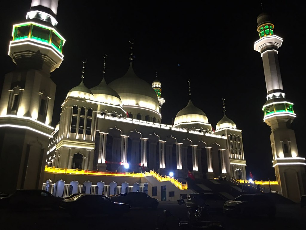 Vehicles are parked outside the Grand Mosque in Weizhou in northwestern China's Ningxia Hui Autonomous Region, early Saturday, Aug. 11, 2018. Thousand...
